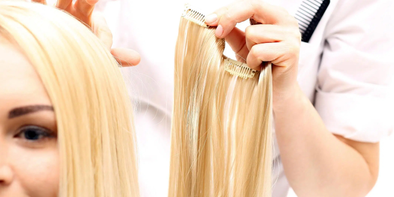 Image Showing A Hair Stylist Going To Fix Hair Extension For a Woman.