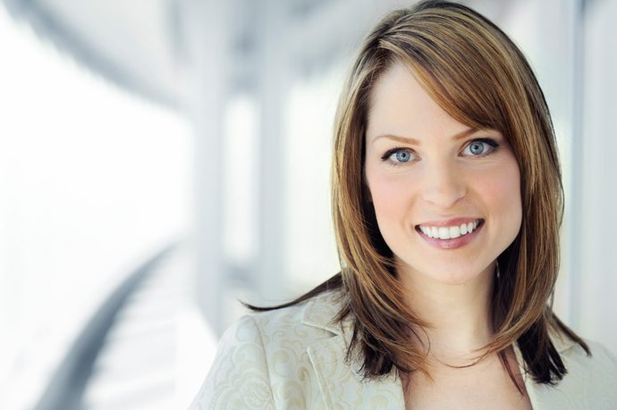 Image of a smiling woman with professional hairstyle.